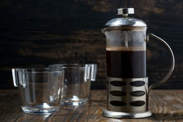 French Press Coffee Maker and 2 empty glass cups