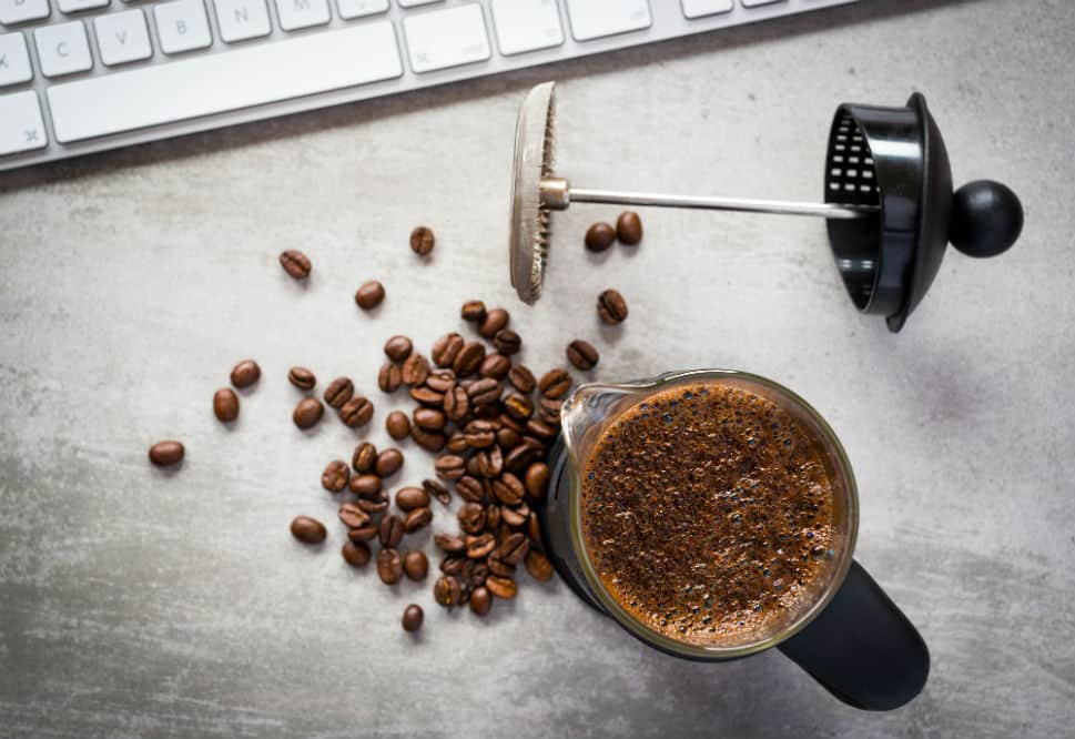 Coffee beans an French Press coffee maker