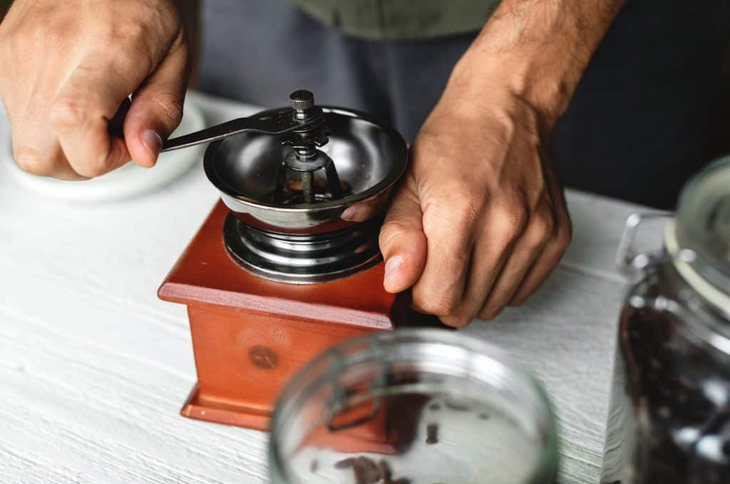 Man using Hand Coffee Grinder
